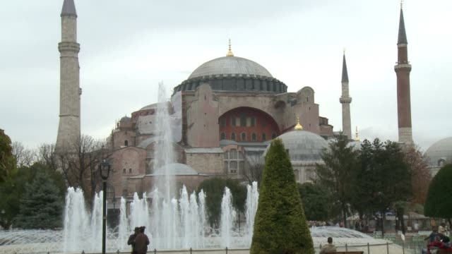 Perched on the tip of Istanbuls historic peninsula Hagia Sophia with its spectacular dome elegant curves and towering minarets is an iconic sight for...