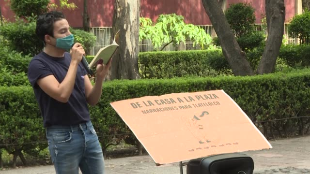 percibald garcia, a young mexican architect, walks around his neighbourhood with a speaker and a book, to read stories and play music to children... - storyteller stock videos & royalty-free footage