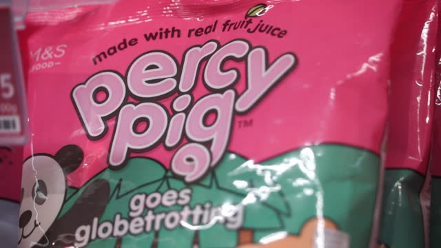 percy pig sweets from marks and spencer that are experiencing some export tax issues due to the brexit trade deal - sweet food stock videos & royalty-free footage