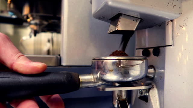 perfect commercial coffee grind for aromatic and strong italian espresso - grinding stock videos and b-roll footage
