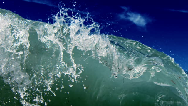 A perfect detailed beautiful wave POV as wave breaks over camera on shallow sand beach in the California summer sun. Shot in slowmo on the Red Dragon at 300FPS.