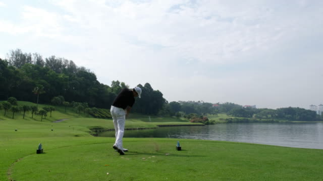 perfect golf shot off the tee box - golf swing stock videos & royalty-free footage