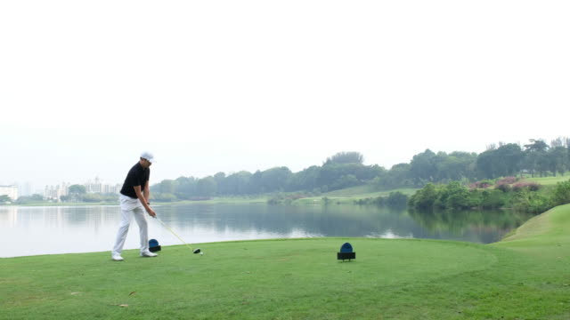 perfect golf shot off the tee box - teeing off stock videos & royalty-free footage