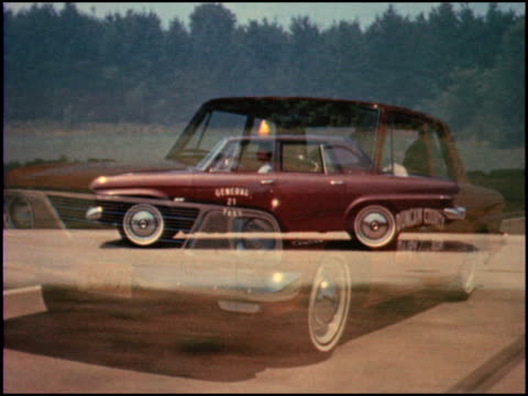 / perfect short segment showing the entire model line up for studebaker in 1964 all shots are tracking shots / ws front threequarter of 4door cruiser... - tre quarti video stock e b–roll