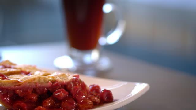 vídeos y material grabado en eventos de stock de perfect slice of cherry pie with lattice crust - clase de economia domestica