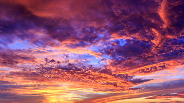 perfect sunset and clouds time lapse - 4k - red cloud sky stock videos & royalty-free footage