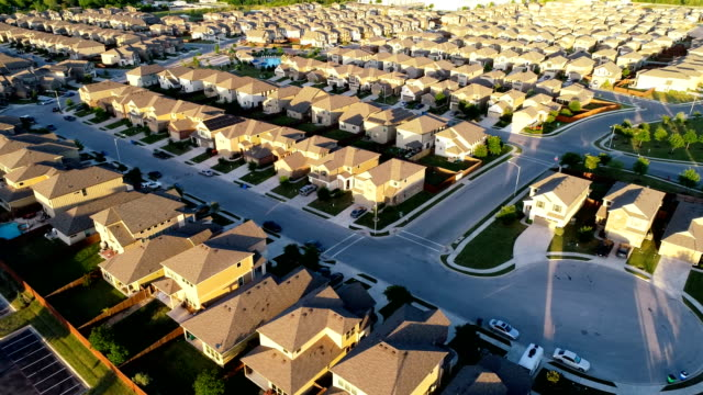 perfect sunset golden hour home ownership suburb drone view endless houses in austin , texas - tract housing stock videos & royalty-free footage