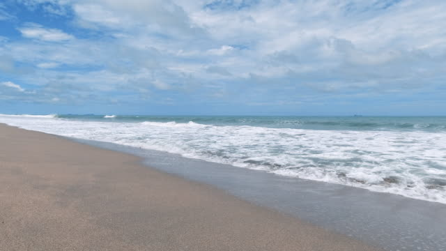 perfect tropical sandy beach sunny day waves breaking on shore background - andaman sea stock videos & royalty-free footage