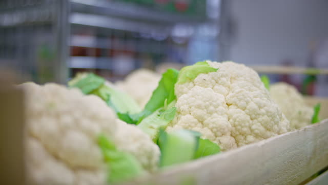 perfect white cauliflower in a wooden crate - cauliflower stock videos & royalty-free footage