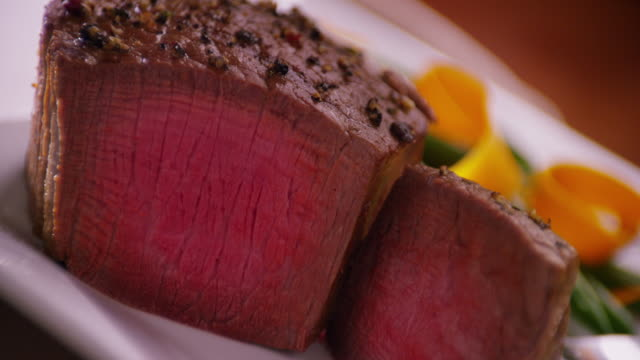 Perfectly grilled steak with a medium rare, pink inside.