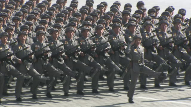 perfectly lined up north korean souldiers marching in lines during an anniversary parade - military parade stock videos & royalty-free footage