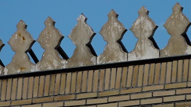 vídeos de stock, filmes e b-roll de perforated window and telephone pole - armação de janela