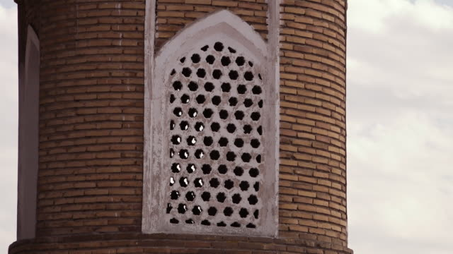 perforated window on circular tower - bukhara stock videos & royalty-free footage