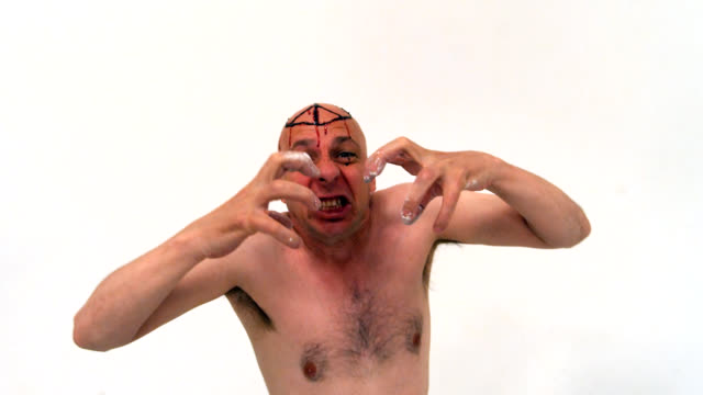 performance art bloody peace sign anger - completely bald stock videos and b-roll footage