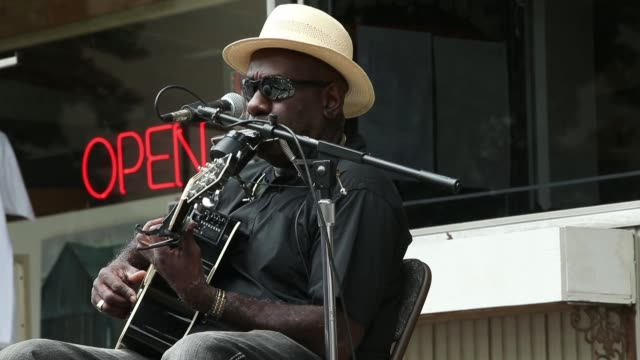 stockvideo's en b-roll-footage met performance mid shot of blues artist richard pryor performs outside the rock blues museum juke joint festival celebrates mississippi blues on april... - richard pryor
