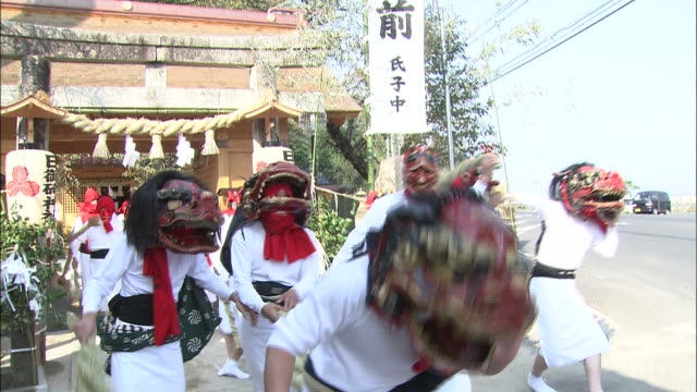 performers dressed as ogres parade along a street during the gatchi festival in japan. - shimane prefecture stock videos & royalty-free footage