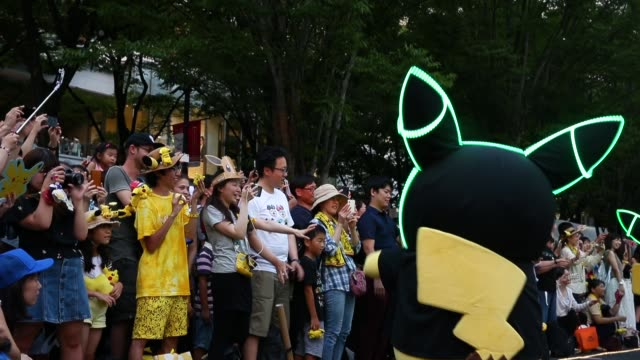 performers dressed as pikachu a character from pokemon series game titles dance during the pikachu outbreak event hosted by the pokemon co on august... - 扮装点の映像素材/bロール