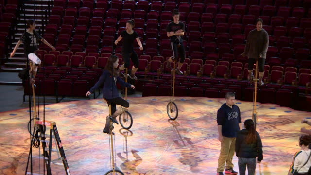 vídeos de stock, filmes e b-roll de performers for the cirque de soleil rehearsing on unicycles at the royal albert hall - entertainment occupation