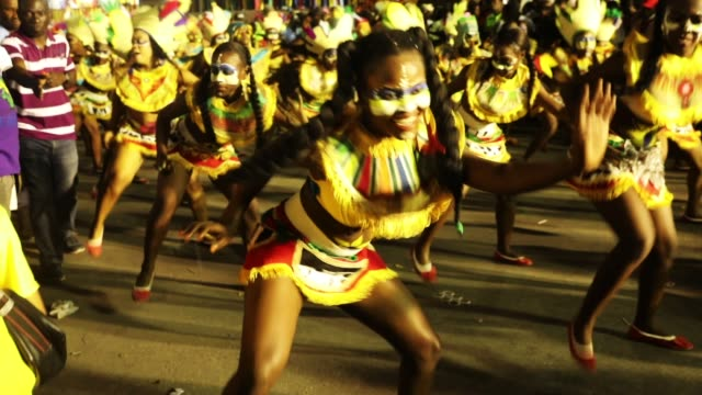 Performers march through the streets of PortauPrince during the first day of Carnival on February 11 2018 in PortauPrince Haiti Haiti the poorest...