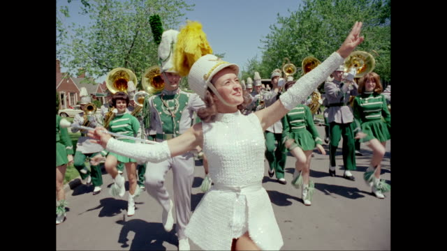 ms performers marching in parade on street during carnival / united states - marching band stock videos & royalty-free footage