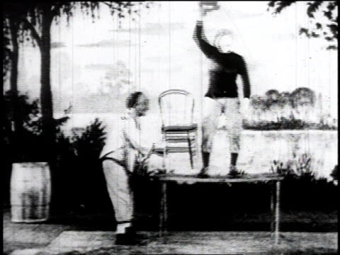 1934 montage performers on stage doing vaudeville acts / united states - theateraufführung stock-videos und b-roll-filmmaterial