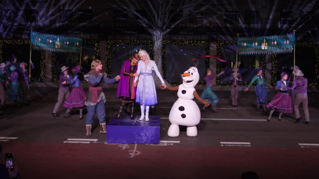 "performers sing at the disney and saks fifth avenue unveil ""disney frozen 2"" holiday windows at saks fifth avenue on november 25, 2019 in new york... - frozen stock videos & royalty-free footage"