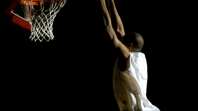 performing a slam dunk (super slow motion) - professional sport stock videos & royalty-free footage