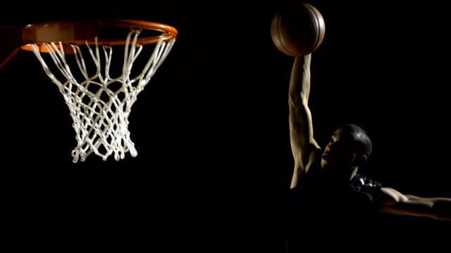 performing a slam dunk (super slow motion) - basketball ball stock videos & royalty-free footage