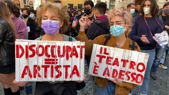 stockvideo's en b-roll-footage met performing arts and culture workers demonstrate in front the parliament building in montecitorio square on february 23, 2021 in rome, italy. with the... - arts culture and entertainment