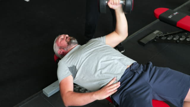 performing dumbbell bench press - bench press stock videos & royalty-free footage