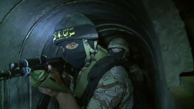 periodistas de afp tuvieron acceso a los tuneles subterraneos donde combatientes de la yihad islamica se preparan para el proximo conflicto armado... - gaza city stock videos & royalty-free footage