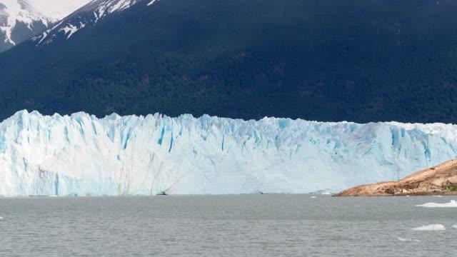 perito moreno glacier against high mountains - telephoto lens stock videos & royalty-free footage