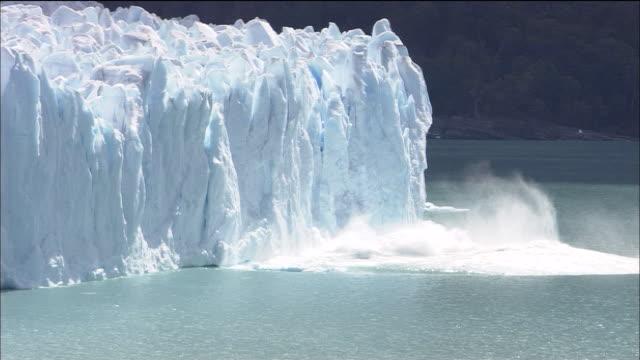 perito moreno glacier calves into sea, lago argentino, patagonia - frozen stock videos & royalty-free footage