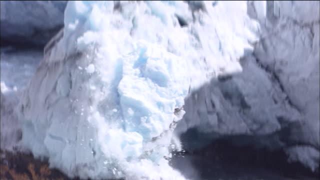 perito moreno glacier calves onto rocks, lago argentino, patagonia - patagonia chile stock videos and b-roll footage