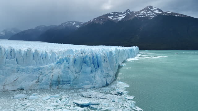 perito moreno glacier with tour boat - glacier stock videos & royalty-free footage