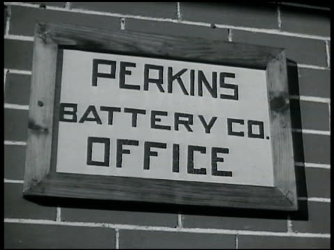 perkins battery co office sign ext large home middleaged male walking out of house putting on cap walking toward car fg - 1935 stock videos & royalty-free footage