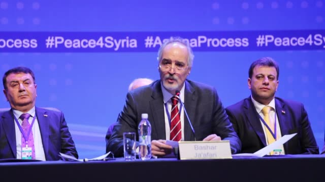 Permanent representative of the Syrian Arab Republic to the United Nations Bashar Jaafari delivers a speech during the second day of Syria peace...