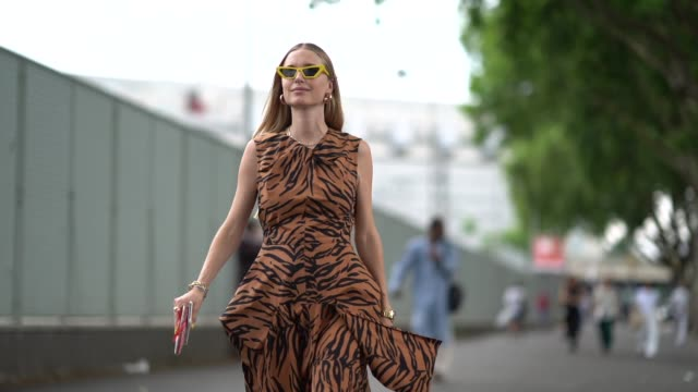 Pernille Teisbaek wears a brown dress with black printed patterns outside Vetements during Paris Fashion Week Haute Couture Fall Winter 2018/2019 on...