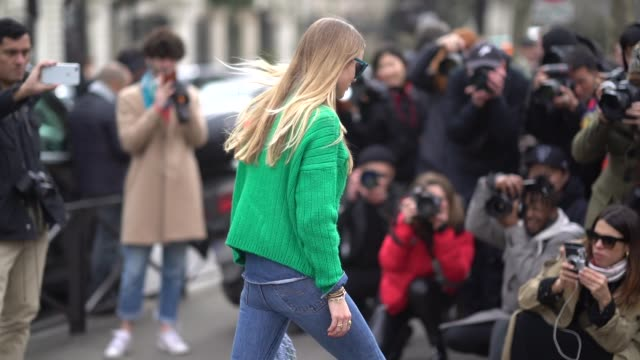 stockvideo's en b-roll-footage met pernille teisbaek wears a green pull over blue jeans a bag blue shoes outside miu miu during paris fashion week womenswear fall/winter 2018/2019 on... - herfst winter collectie