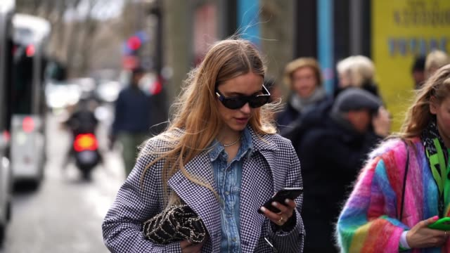 pernille teisbaek wears sunglasses a blue denim shirt a black and white houndstooth pattern printed long coat with floral print inner lining a chanel... - zebra print stock videos & royalty-free footage