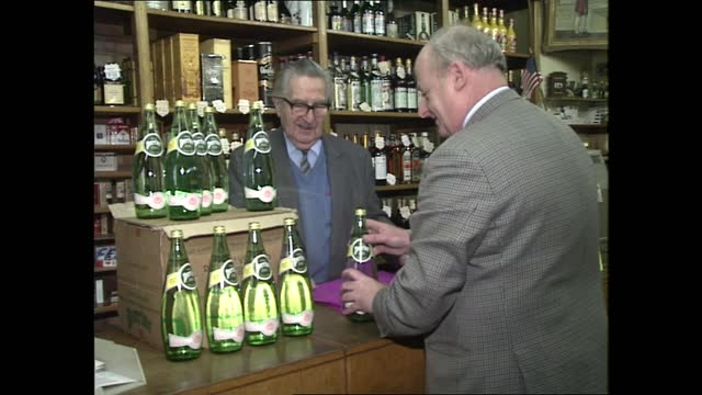 benzene contamination; england: london: int bottles of perrier on counter as woman wrapping bottles of alcohol in paper / perrier bottles / people... - molecule stock videos & royalty-free footage