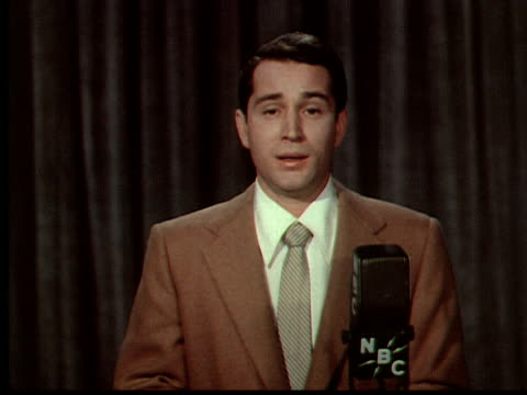 perry como looking at camera while singing 'because' - kompletter anzug stock-videos und b-roll-filmmaterial
