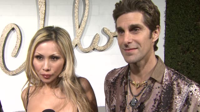 perry farrell and etty lau farrell on what they're doing at tonight's event, on why they wanted to be part of the event, on what they like about... - perry farrell stock videos & royalty-free footage