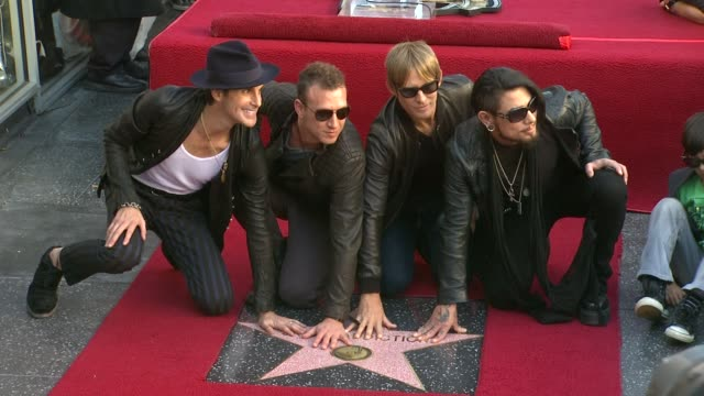 perry farrell, stephen perkins, chris chaney and dave navarro at jane's addiction honored with star on the hollywood walk of fame, on - perry farrell stock videos & royalty-free footage