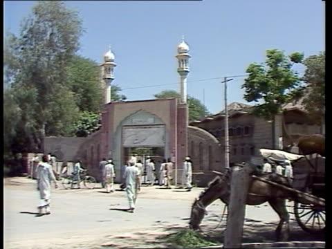 persecution of members of the ahmadiyya sect pakistan punjab rabwah men walking away towards gateway of mosque bv men and boys entering mosque... - punjab pakistan stock videos and b-roll footage