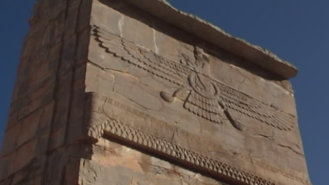 persepolis lowangle mcu of the winged deity symbol representing ahura mazda the creator god of zoroastrianism from a frieze in persepolis the city... - fries säulengebälk stock-videos und b-roll-filmmaterial