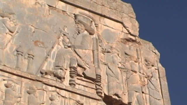 persepolis lowangle view of a king on a throne from a frieze at the ancient city of persepolis the city dates to 515 bce and is a unesco site - persepoli video stock e b–roll
