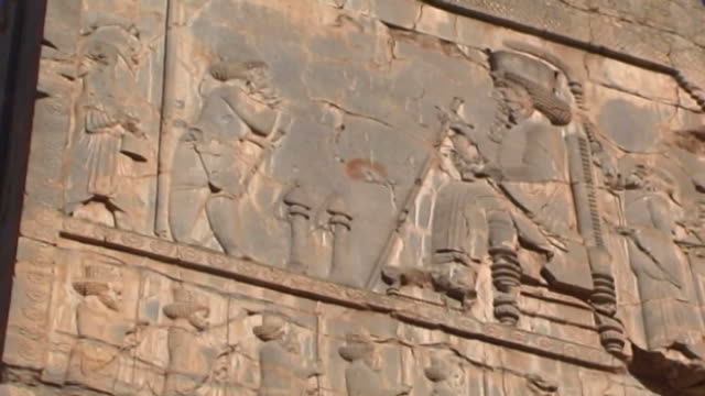 persepolis lowangle view of a king on a throne from the top register of a frieze at the ancient city of persepolis the city dates to 515 bce and is a... - persepoli video stock e b–roll