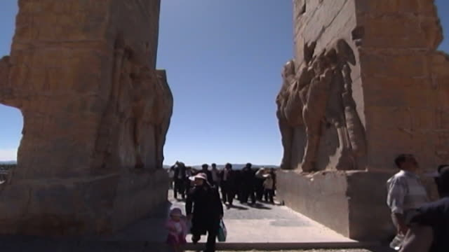 persepolis rear view of the massive stone lamassu protective deities decorating the gate of all nations in the ruins of the ancient city of persepolis - persepoli video stock e b–roll