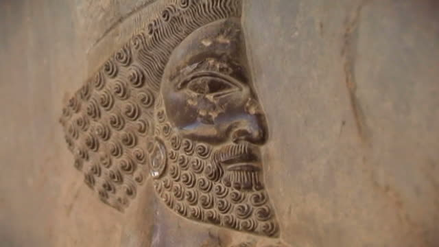 persepolis view of the face of a medes nobleman from the bas reliefs at the apadana palace in persepolis the city dates to 515 bce and is a unesco... - persepoli video stock e b–roll